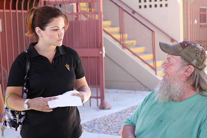 ASU intern Kim Speed talks with a resident at Ozanam Manor.