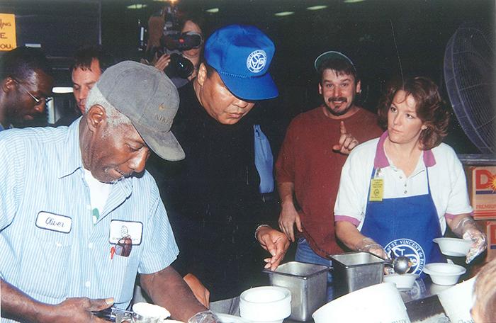 Muhammad Ali helps serve in SVdP's dining room.