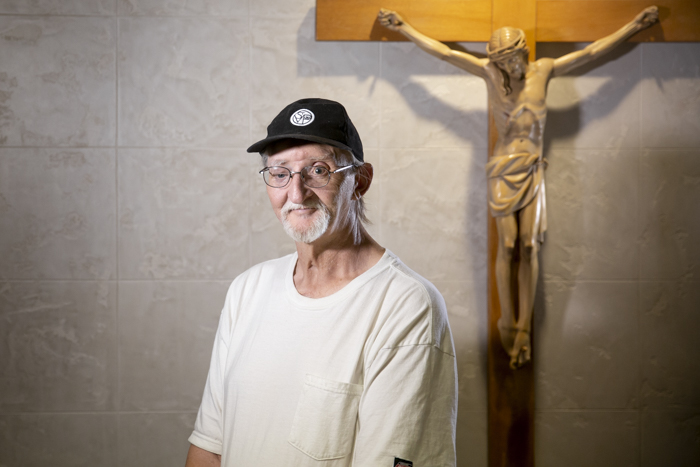 John Apperson stands in the small chapel at Ozanam Manor, St. Vincent de Paul's shelter.
