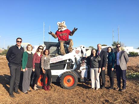 Arizona Diamondbacks staff and mascot Baxter the Bobcat pose for a photo during the groundbreaking event.