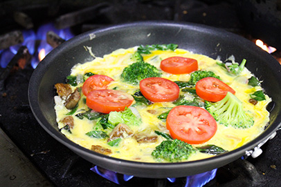 Chef Chris cooks a farm-fresh veggie frittata in SVdP's kitchen.