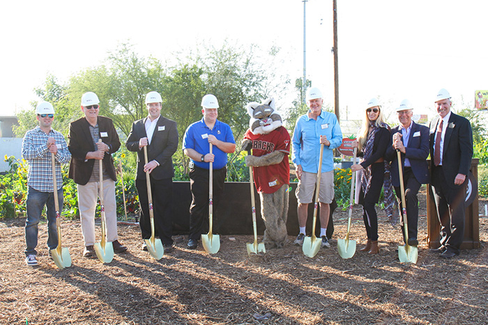 Local partners and supporters pose for a groundbreaking photo in SVdP's Urban Farm.
