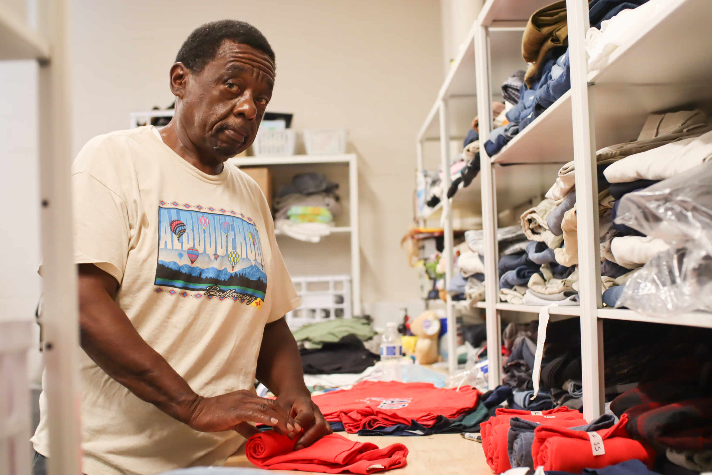 Resource Center volunteer Brian Lynch folds and sorts incoming items before they are distributed to guests.