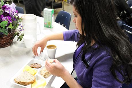 Jasmine eats breakfast in SVdP's downtown dining room.