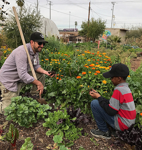 Sahar and Tony work in the Urban Farm together.