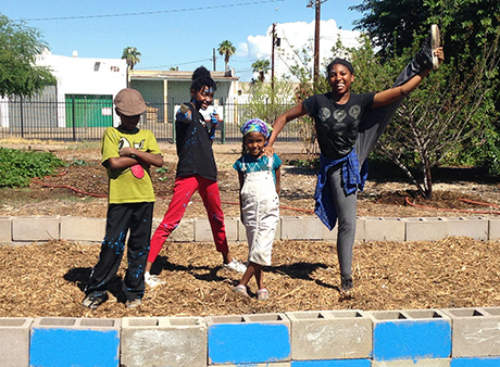 Selah, Serenity, Sahar and Saitara pose for a photo in the garden.