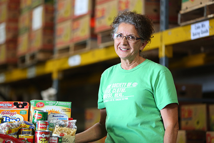Mary Thomas, SVdP food warehouse manager, poses for a photo in the food warehouse.