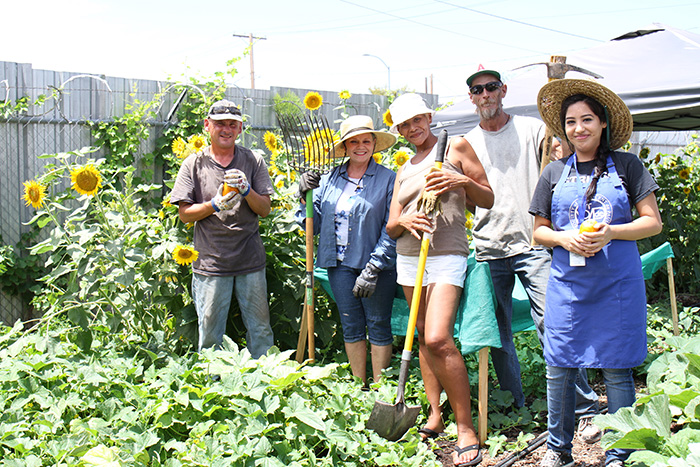 Volunteers pose for a photo at the Mesa Dining Room urban farm.