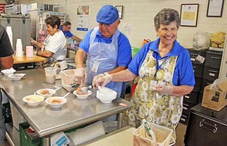 Pete and Ersie Salcido scooping ice cream