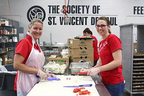 Wells Fargo employees volunteer in St. Vincent de Paul's kitchen.