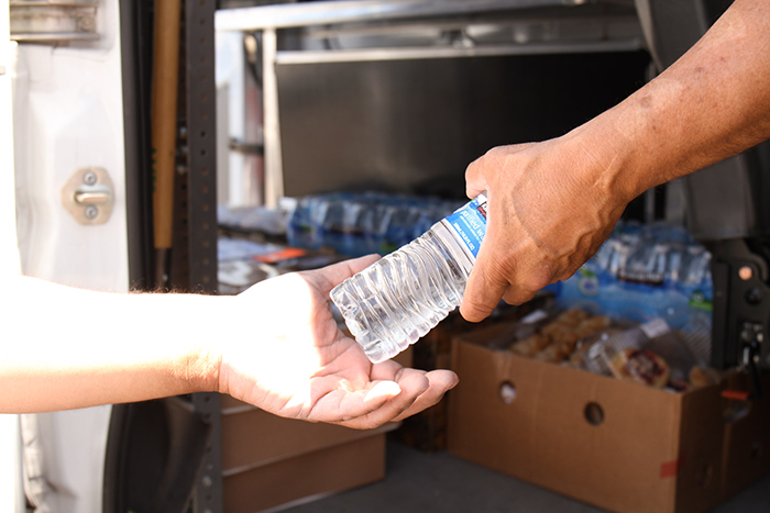 Handing out water to the homeless