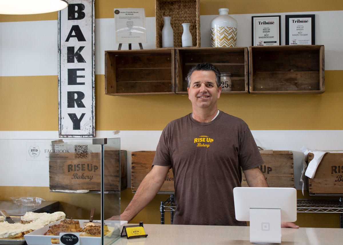 Jay Lunt, owner and operator of Rise Up Bakery, at his shop's counter