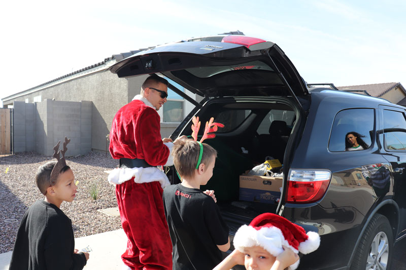 Delivering Christmas to a family in need - The Catholic Sun